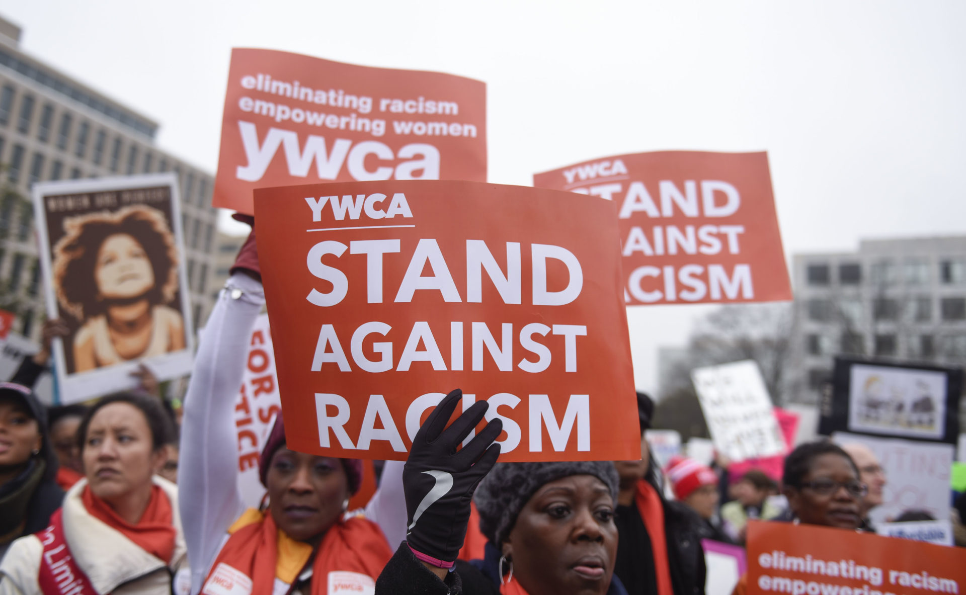 Protest signs that say Stand Against Racism - racial justice award